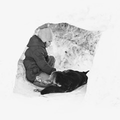 Girl playing with a dog in winter