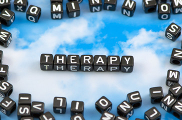 The word therapy on the sky background