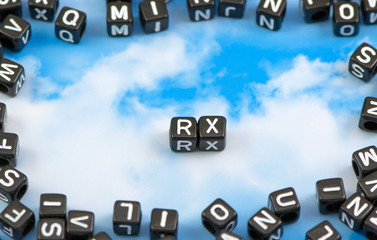 The word RX on the sky background