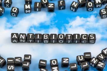 The word Antibiotics on the sky background