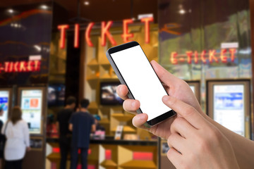 human hand hold and touch smartphone, tablet, cell phone with blurry ticket center.