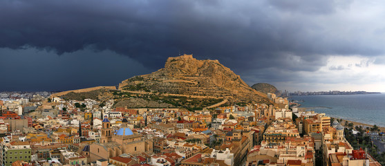 Alicante city and Castillo de Santa Barbara before storm, Spain