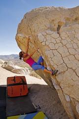Woman Climbing Boulder