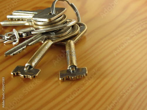 """Bunch of worn house keys on wooden table"" Stock photo and ..."