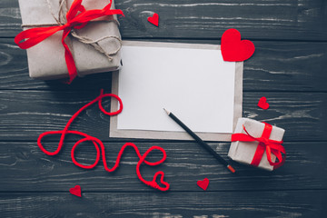 Valentine's Day. love letter, heart felt and presents on wooden background