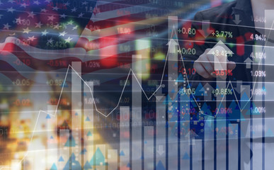 Double exposure of business woman and stock market design with USA flag
