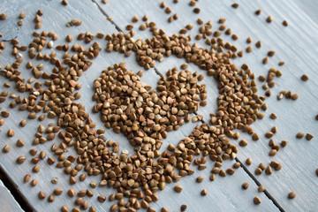 buckwheat porridge on wooden board heart-shaped