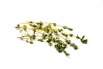 Fresh thyme sprigs lie on a white background, not isolated.