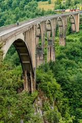 View of the old concrete arch Bridge Djurdjevica Tara in Montenegro.