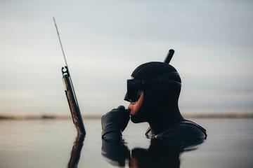 Scuba diver spearfishing in sea