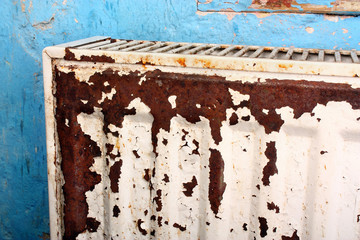 Rusty, destroyed, devastated, moldy radiator
