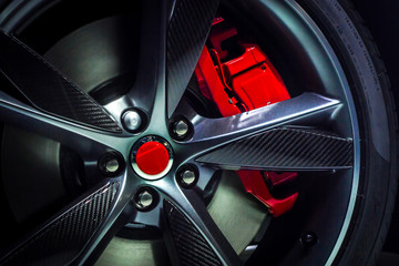 Closeup of an beautiful large Alloy wheel of luxury car with painted brake callipers Wall mural