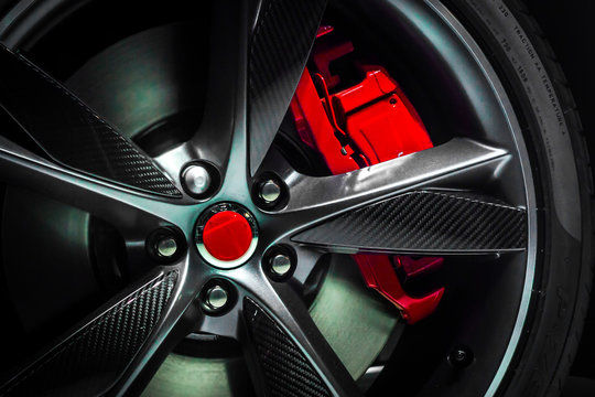 Closeup of a beautiful large Alloy wheel of luxury car with painted brake callipers