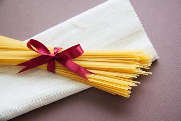 raw italian noodles spaghetti on table in kitchen