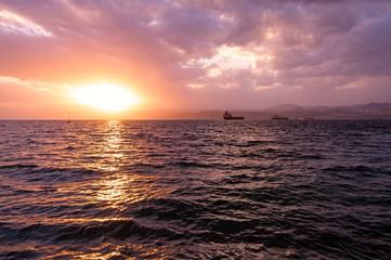 Bright sunset at Gulf of Aqaba. Red sea, Jordan.