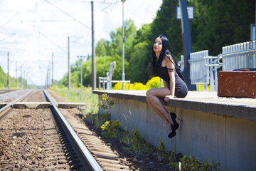 young woman waiting train