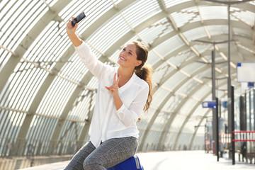 smiling travel woman taking selfie
