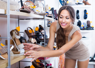 young woman customer in shoes store.