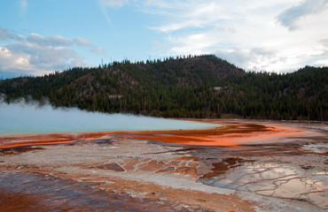 Grand Prismatic Spring under sunset clouds in Yellowstone National Park in Wyoming USA