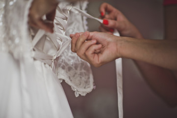 The process of dressing up the bridesmaid dresses for the weddin