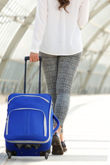 Travel woman walking away with luggage