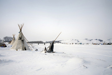 Tipi at the edge of the frozen Cannon Ball River, Cannon Ball, North Dakota, USA, January 2017
