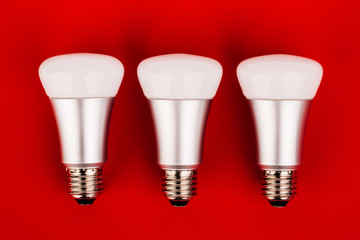 energy saving wifi light bulb on red  background.
