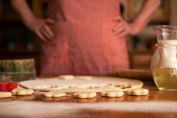 senior woman preparing delicious cookies