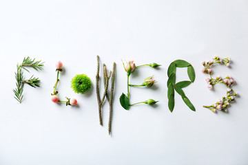 Word Flowers made of plants on white background