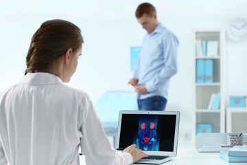 Medical concept. Doctor looking at laptop screen with urology system image