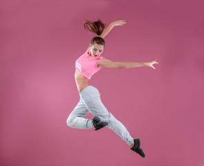 Hip hop dancer dancing on pink background