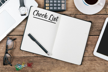 Check List text on note pad, Office desk with computer technolog