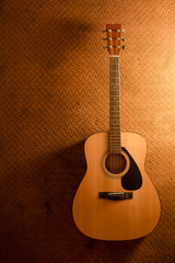 Acoustic guitar on old steel background with copy space