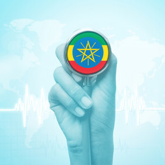 hand holding stethoscope with Ethiopia flag.