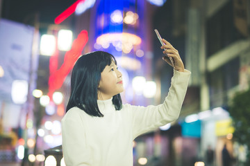 Asian girl taking photo selfi