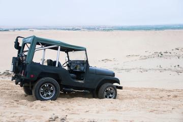 Jeep car with white sands. Vietnam desert,Popular tourist attrac