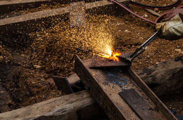 photo of worker doing gas cutting on steel