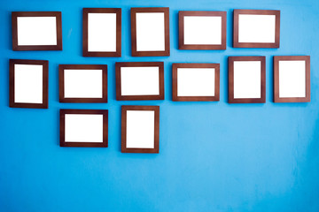 Photo frames on the colorful wall