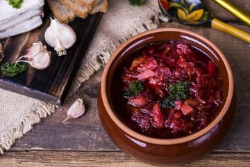borsch soup and garlic on the table