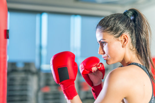 Beautiful girl exercising with kick box training. Fitness and he