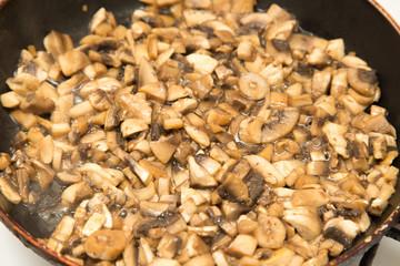 mushrooms fried in a pan