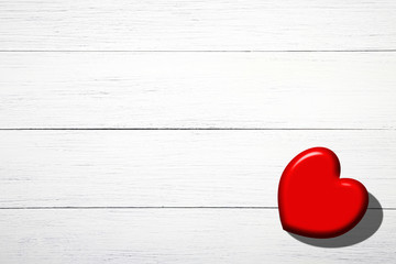 Red heart on white boards, on Valentine's Day