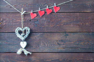 Vintage White Heart and Small Red Hearts cut out with Clothespins on Rustic Wooden Background, Valentines Day or Wedding Wallpaper, Free Space for Text