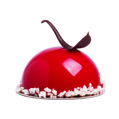 French mousse cake covered with cherry glaze isolated on white. Red modern European dessert with chocolate decoration.