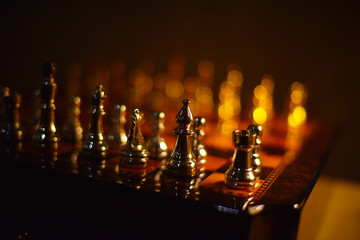 Gold and silver chess pieces on the Board close-up