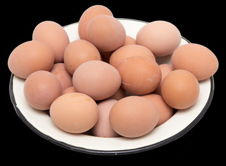 boiled eggs in a bowl on a black background