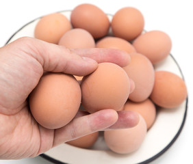 boiled eggs in his hand
