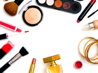 cosmetics top view on a white table. Workplace, cosmetics, lipstick, nail Polish, mascara and eyeshadow