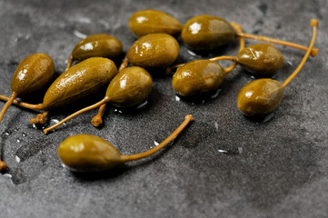 Green capers on a rustic background