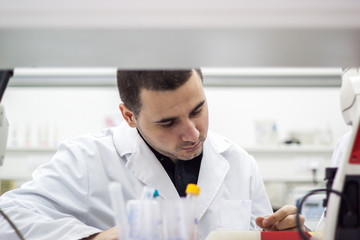 Young doctor conducts research, and it is very concentrated and